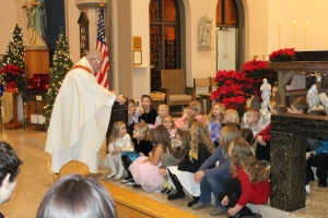 Fr. Ron and the children at St. Joseph