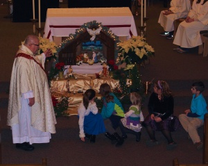 Fr. Ron and the children at St. Alphonsus